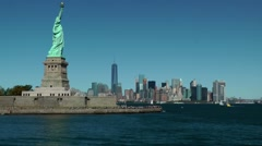USA New York City 399 passing statue of liberty in front dreamlike skyline Stock Footage