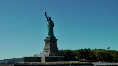 USA New York City 398 passing statue of liberty in front dreamlike blue sky Stock Footage