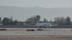 Alaskan Horizon Bombardier Airplane Day Landing at SJC Stock Footage