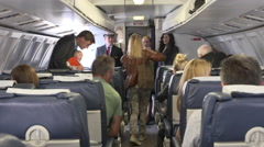 Passengers getting off plane after flight Stock Footage