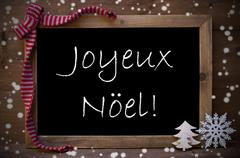 Chalkboard  Joyeux Noel Mean Merry Christmas, Snowflakes - stock photo