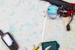 fishing journey with tackles and gps navigator - stock photo