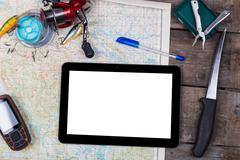 mockup with fishing tackles and navigator on map - stock photo