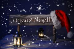 Sign Candlelight Santa Hat Joyeux Noel Means Merry Christmas - stock photo