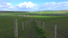 Wide shot of the green fields of the Orkney Islands of Scotland. Stock Footage