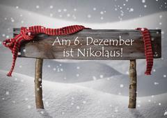 Sign Nikolaustag Mean St Nicholas Day, Snow, Ribbon, Snowflakes - stock photo