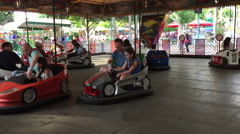 Bumping cars in amusement park Stock Footage