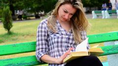 Stock Video Footage of Girl attentively reading a book about agriculture
