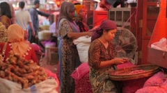 Woman sorting onions in Pasar Pabean,Surabaya,Java,Indonesia Stock Footage