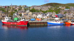 Establishing shot from a boat of the port at Stromness, Orkney Islands, Stock Footage