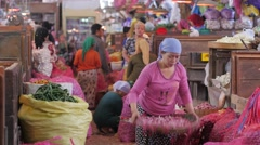 Woman cleaning onions in pasar Pabean market,Surabaya,Java,Indonesia Stock Footage