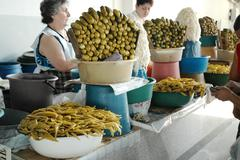 Pickled cucumbers and peppers in the bazaar of Yerevan market, Armenia - stock photo