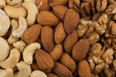 Mixed nuts background above closeup Stock Photos