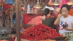 Chili seller in Pasar Pabean market,Surabaya,Java,Indonesia Stock Footage