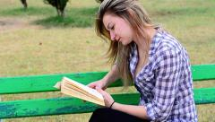 Woman attentively reading a book about agriculture - stock footage