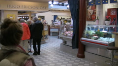Shoppers walking around inside a Swedish indoor market Stock Footage