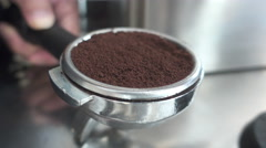 Close-up tamping fresh ground coffee in the bucket , 4K Stock Footage
