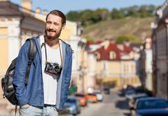Handsome young guy is making journey across town - stock photo