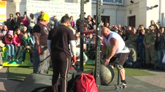 The athlete over the bar throws a stone ball 160 kg Stock Footage