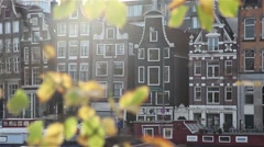 Amsterdam buildings, focus from tree - stock footage