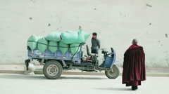 Monks leave Grand Sutra Hall of Labrang Monastery after prayers Stock Footage