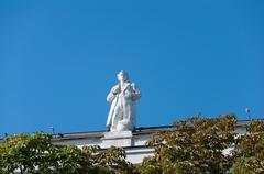 Moscow, Russia - 09.21.2015. Moscow. The sculptures on the roof State Library - stock photo