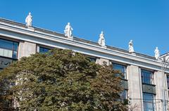 Stock Photo of Moscow, Russia - 09.21.2015. Moscow. The sculptures on the roof State Library