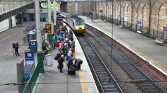 A train arrives at a station in a generic European city. Stock Footage