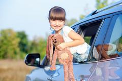Pretty female child is playing in transport - stock photo