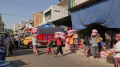 Female workers carrying onion bags on head,Surabaya,Java,Indonesia Stock Footage