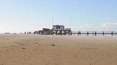 Restaurant Pier at Sankt Peter Ording beach, Germany Stock Footage