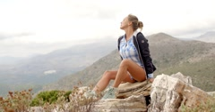 Fit Woman Resting at Rock Stock Footage