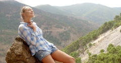 Girl Resting Near Rock in Spanish Mountains Stock Footage