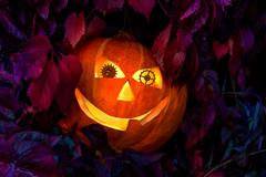 Small Halloween pumpkin with eyes of clock gears - stock photo