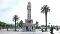Izmir clock tower and crowded people visiting city center square Stock Footage