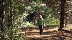 Mature Caucasian Woman Walking In A Forest Stock Footage