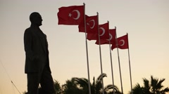 Ataturk statue and Turkish flags waving at Izmir Stock Footage