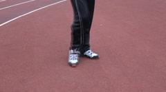 Runner warming up  legs flexing Stock Footage