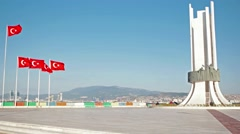 Ataturk statue and Turkish flags waving at Izmir Karsiyaka Stock Footage