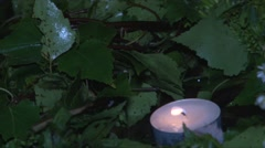 Candle on the raft leaves in water large Stock Footage