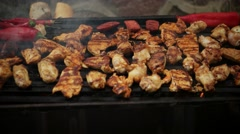 Barbecue grilling chicken and vegetables Stock Footage