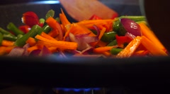 Frying and mixing vegetables close up video - stock footage