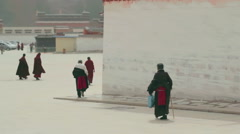 Tibetan Buddhists roam the streets of Labrang Monastery, Xiahe, China - stock footage