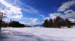 4K Beautiful Winter Timelapse - Snow and clouds in a perfect blue sky Stock Footage