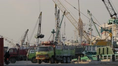Ships being loaded in Kalimas harbour,Surabaya,Java,Indonesia Stock Footage