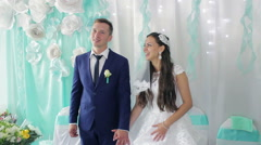 Bride and groom on their wedding clap,  laugh and kiss Stock Footage