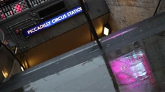 Piccadilly Circus metro station entrance, raining day Stock Footage