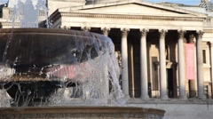 National Gallery and Trafalgar fountain in the square in london Stock Footage