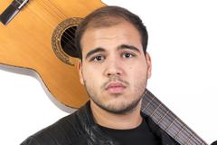Young Man With an Old Acoustic Guitar - stock photo