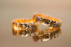 Wedding rings in gold and diamonds - stock photo